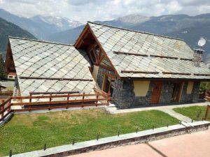 Immagine copertura tetto con lose in pietra di Luserna